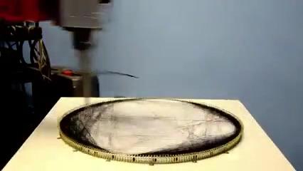 رباتی برای دوختن چهره افراد روی پارچه